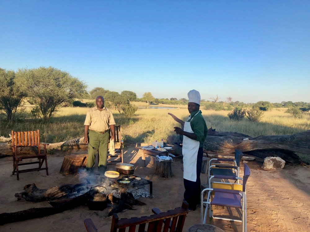 Jozibanini, cooking on an open fire, Hwange NP